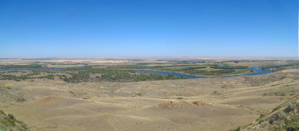 Blue river winds through plains