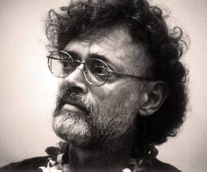 A black and white photograph of Terence McKenna who argued for psychedelics towards environmental identity
