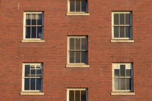 windows on a red brick wall