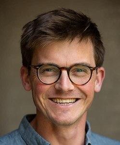 Portrait photograph of smiling man with glasses, Dr. Jamie Lorimer.