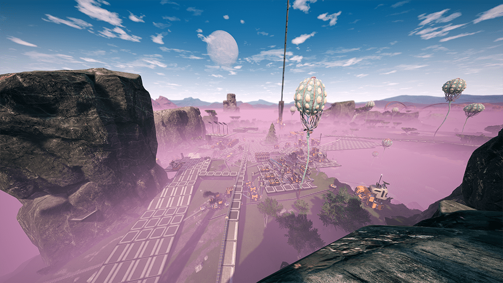 Screenshot of video game, a pink fog sits over the landscape and a space elevator sits in the distance.