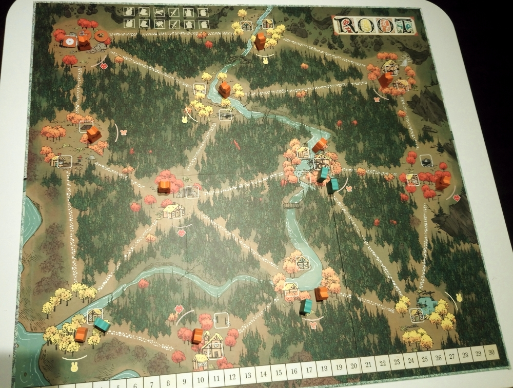 The game board for Root is opened up with different colored game pieces on it.