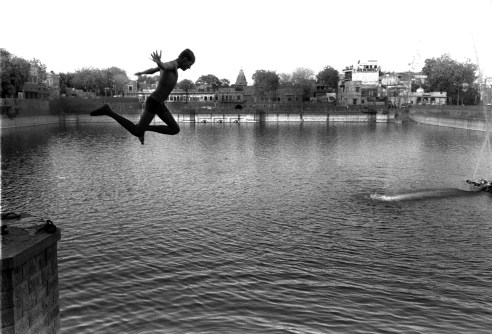 Boy is jumping into the lake to escape summer heat Jodhpur, Rajasthan, India
