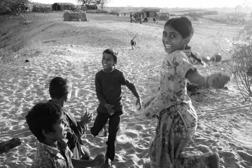 Children playing in the desert village Rural Rajasthan, India