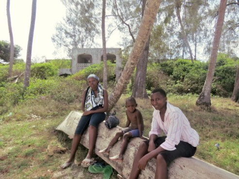 A rare middle class family outside the ruined Tradewinds resort, Diani Beach