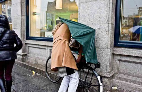 """""""Trying to reach home dry"""" Amsterdam, Netherlands"""
