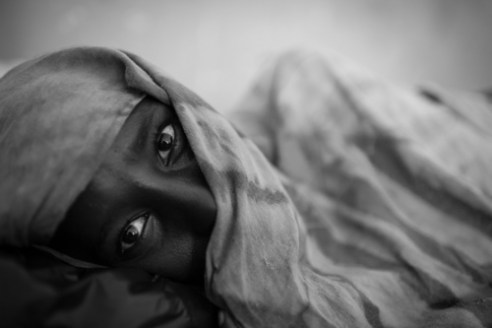 A 15 year-old refugee continues treatment for malnutrition at the Banadir Hospital in Mogadishu just after giving birth.