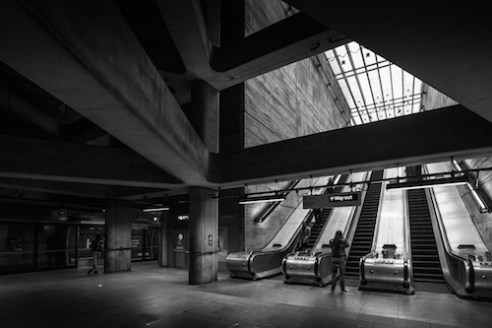 Straight Up the Middle. The amazing beams of the modern Bermondsey tube station opens up the station giving a much brighter and open feel than the older tube stations in London.