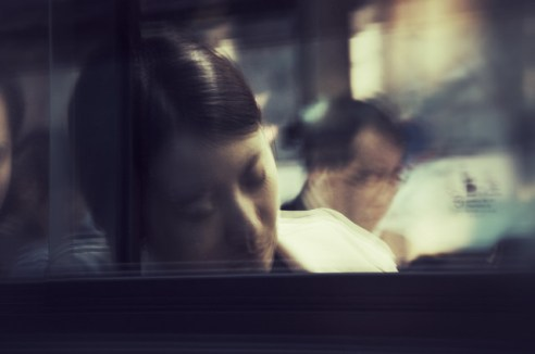Waking up in Seoul: A woman naps on a Seoul bus. South Korea