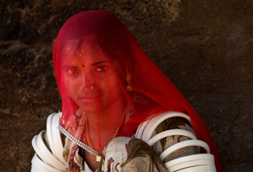 Gadalia woman with traditional rings around the upper arms.