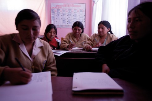 Women begin to occupy the desks in vocational schools, universities, etc..