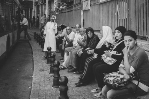 Bus Stop June 11, 2015 - Pedestrians await a bus in Nazareth.