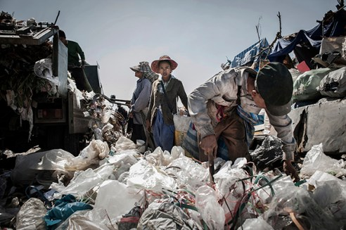 Mae Sot, Thailand; February 2014. A young Burmese collects recyclable materials from landfill.