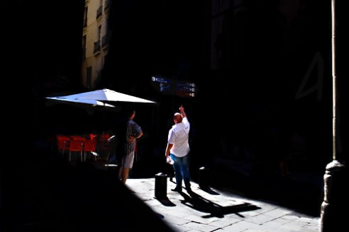 Tourists seeking streets directions in El Born. Barcelona, Spain