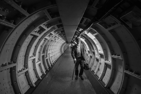 Time Tunnel Travelling through time in the time tunnel. The Doctor comes up through the cast iron tunnel running below The Thames. There are many interesting characters in London with many interesting places to find them. Greenwich foot tunnel is an ancient tunnel that runs from one side of the huge Thames River to the other.