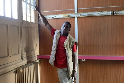 Migrants inside disused fire station