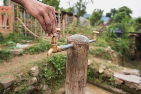 One of the 16 distribution taps providing drinking water to 32 households in Farmer Dilli Ram Regmi's community in Sirubari, rural Nepal.