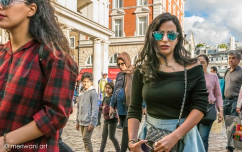 Covent Garden, Central London, Two glamour's ladies enjoy the sunny day in the beautiful environment