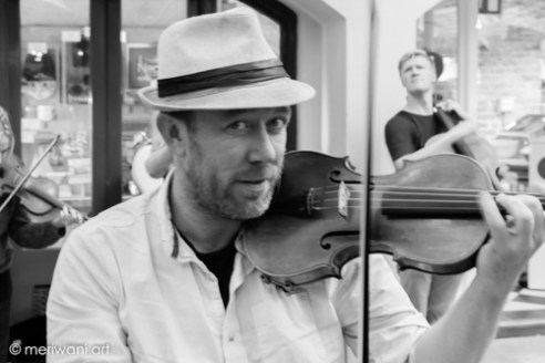 Covent Garden, Central London, Street Violinist plays classical music as part of a team in the vibrant environment