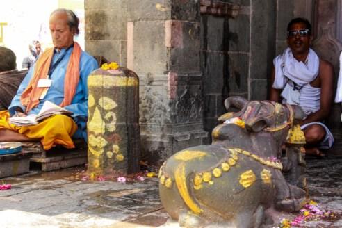 Old Naga Sadhu taking sleep in his worship area.
