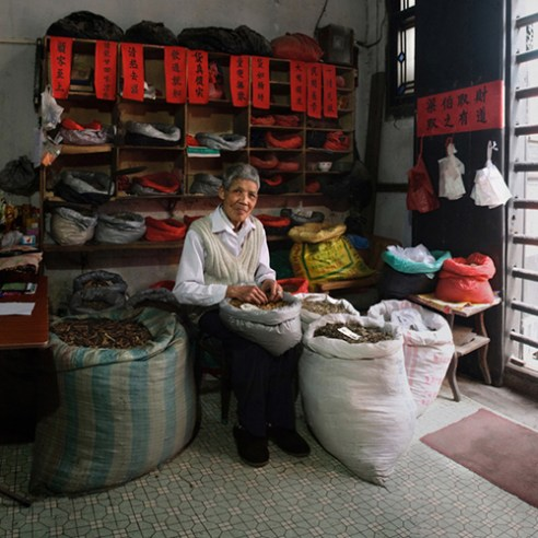 Shixiong Liang, a barefoot doctor. He began to learn traditional Chinese medicine from his father when he was young. He said he felt bad when there were many patients, and would work until finished. He only ate porridge usually.