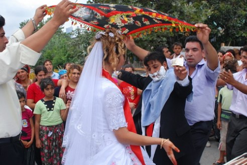 For a longer marriage Bride and groom He has shaving foam on his face and a little money in his hand. They are dancing under a scarf that symbolizes to stay married for a long time. Istanbul - 2007