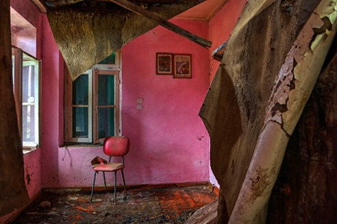 Chair, in an abandoned house. Lefka Village, Greece.