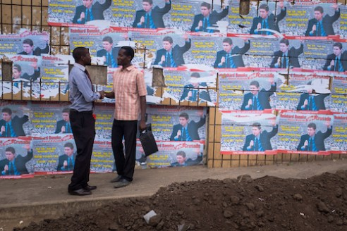 A street-side greeting in front of posters advertising a prayer rally headed by German Pentecostal evangelist Reinhard Bonkke in the town of Blantyre.