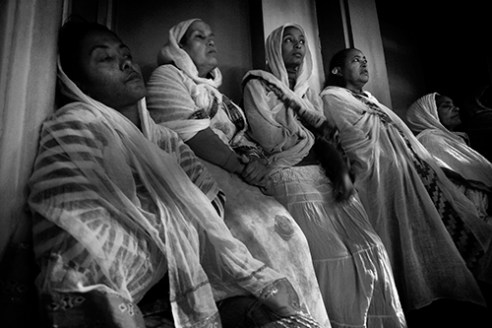 Eritrean women listening to the priest.