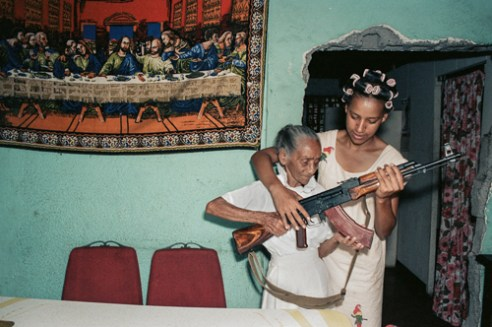 Milena Montano helps her great aunt, La-Conchita, pose with the AK47.