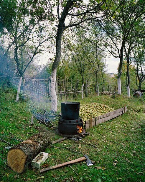 Making apple brandy in the garden of a former mine worker in Rosia Montana