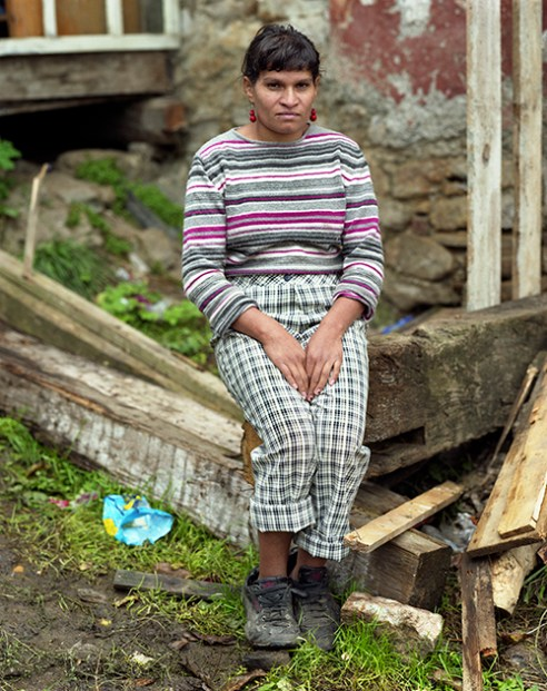 Roma woman in front of her house in Rosia Montana