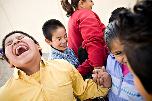 "From left, Eulogio Felix, 9, Sergio Valesquez, 6, ÒTiaÓ Lourdes Martinez, and Jennifer Hernandez, 7, play in the courtyard of the orphanage. Despite their situation, the children always find ways to have fun. From ""Orphaned at the Border,"" January 1, 2007 in Agua Prieta, Sonora, Mexico."