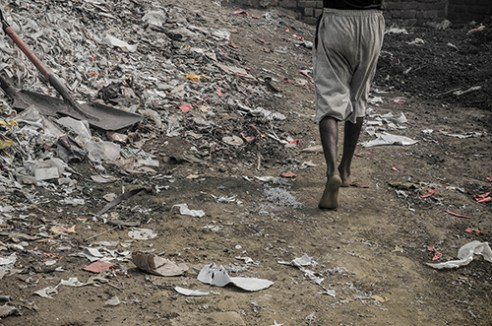 Walking On No protection devices like masks or footwear are provided .The workers themselves are so poor that they do not care about any exposure to hazardous substances that can harm them. Mumbai, India.