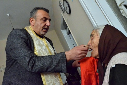 Sometimes members of the congregation become very old and can not go to church for the ceremonies. Father Dimitri visits these people in their homes and gives their holy communion.