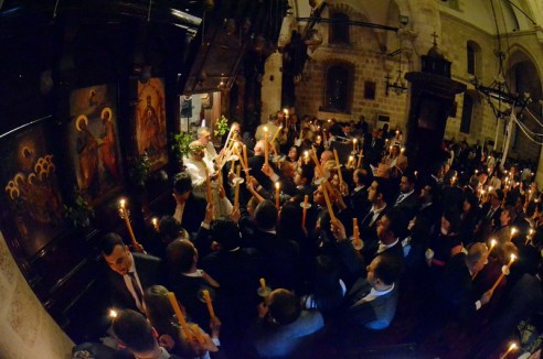 On Easter morning at 4:30 AM, Easter candles are lit with the holy fire brought inside a storm lantern from the Church of the Holy Sepulcher in Jerusalem.