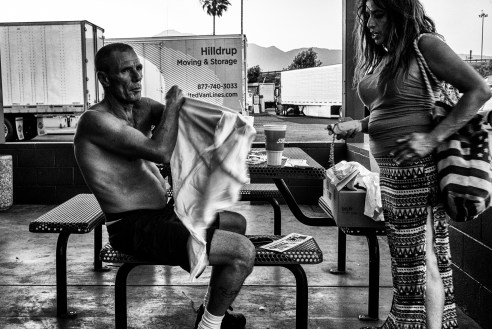 Truck driver Carlos Jordan receives a Truckers for Trump T-shirt from Lorraine Morrison at a truck stop in Ontario, Calif. The trucking industry has long been considered the backbone of American commerce moving materials and dry and raw goods throughout the U.S. generating $255b in yearly revenue.
