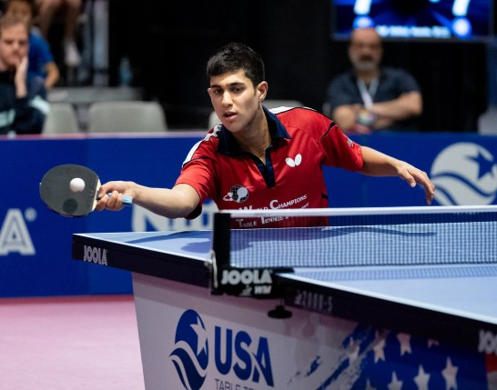 Kanak Jha pushes a ball en route to winning his record fourth consecutive national title in 2019.