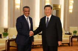 The director of the WHO shaking hands with the President of China