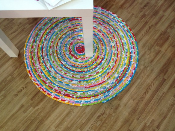 Isn't this a great idea for a kid's room?  Same idea as the corded bowls we've made but just lays flat with fabric wrapped around the cording.  At the Ella Blue booth.