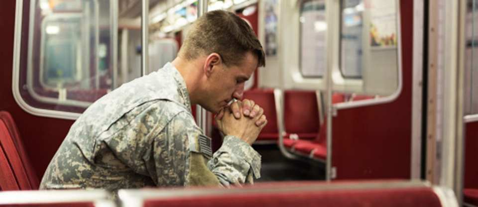 TORONTO-CLINIC_167154438-soldier-alone-in-train-gettyimages