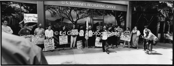Anti war activiat Kyle Kajihiro (center) leads a protest march to Marines Recruiting Office near Ala Moana Center. 9123-1-26 2005