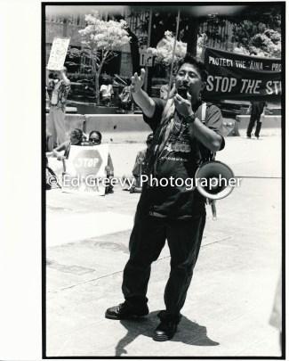 Veteran anti war activist Kyle Kajihiro addresses anti war protesters at the Fes]deral Building. 9123-6-34 C2003_