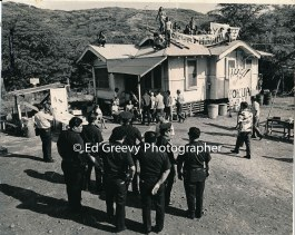 Kalama Valley eviction protesters with drew to the roof of one of the homes. (photographer and date un known) _
