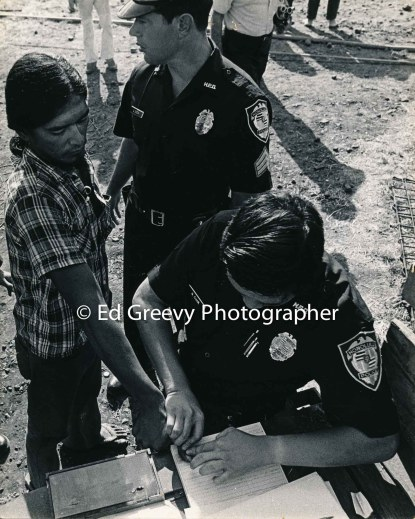 Kalama Valley resident Black Richards is arrested and finger printed. (photographer and date unknown)