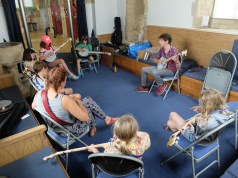 Teaching banjo to kids at the Trad Academy Summer Camp