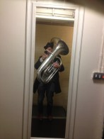 I can't play the tuba but I can carry one