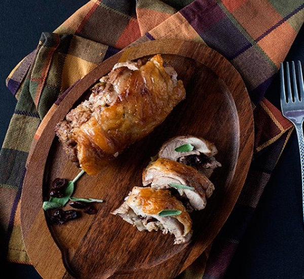 roasted turkey thighs stuffed with dried cranberries, mushroom and sausage