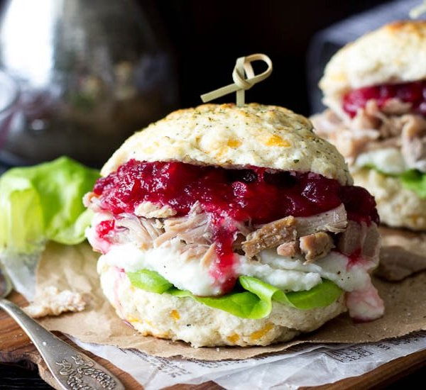 stuffing biscuit, turkey, mashed potato, and cranberry sandwich