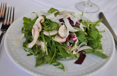 restaurant salad with mushrooms and cheese